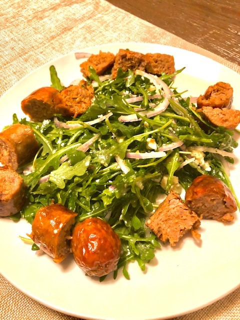 plate with salad greens and sausage