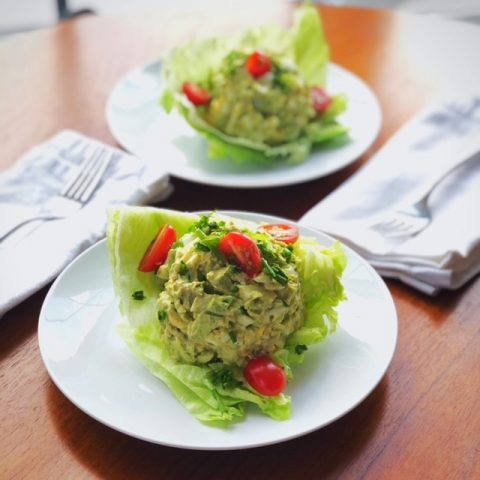 white plate with a lettuce cup and avocado/egg salad