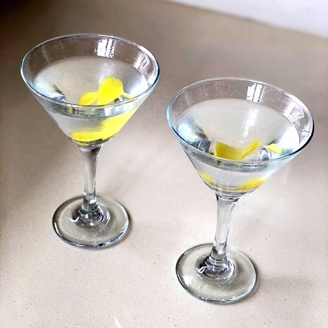 two vesper martinis on a counter