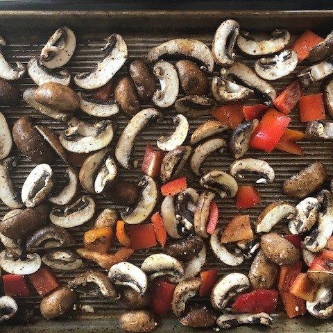 mushrooms and red pepper on a sheet pan